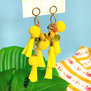 Long summer earrings with yellow paper tassels, colorful glass beads and natural seeds