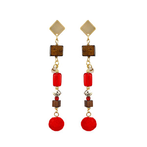 Designer gold-plated dangle earrings with red pom poms, wood beads, natural seeds and glass beads