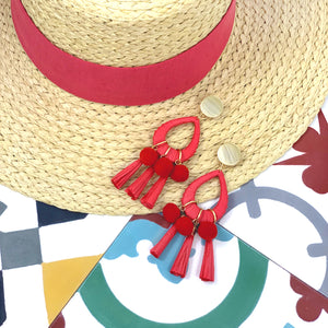Summer straw hat and oversize red raffia tassel earrings with red pom poms and gold-plated round coin posts