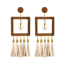 Load image into Gallery viewer, Statement geometric wooden earrings with paper tassels and natural Cowrie sea shells