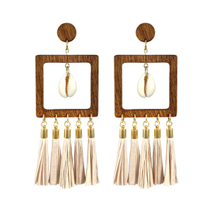 Statement geometric wooden earrings with paper tassels and natural Cowrie sea shells