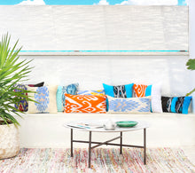 Load image into Gallery viewer, Colorful Uzbekistan silk ikat decorative pillows on an outdoor counch