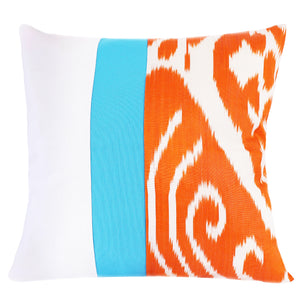 Square pillow cover with orange and white silk ikat fabric and turquoise contrasting stripe