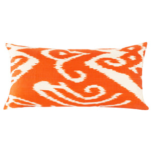 Long lumbar decorative pillow cover in bright orange and white silk ikat fabric from Uzbekistan