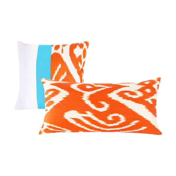 Set of square and long lumbar pillow covers in bright orange and white ikat fabric
