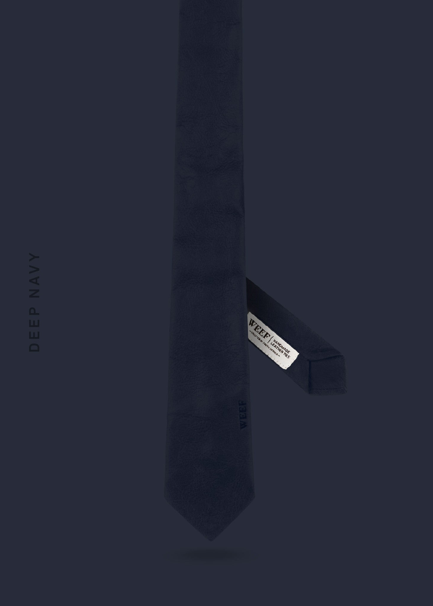 This deep navy WEEF handmade leather tie is a great present or gift idea for dapper and stylish gentlemen for fathers day, valentines day or Christmas.