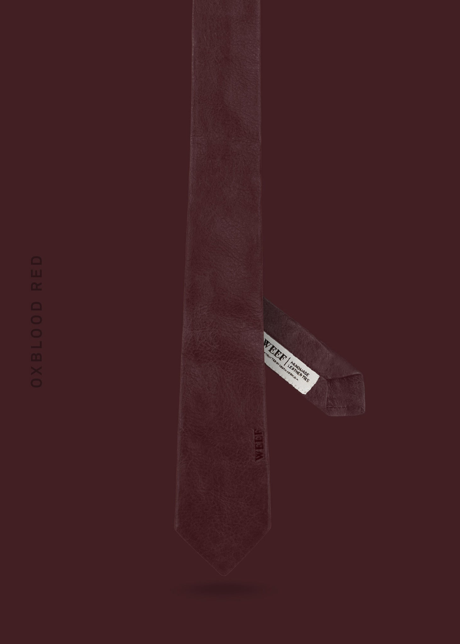 This oxblood red WEEF handmade leather tie is a great present or gift idea for dapper and stylish gentlemen for fathers day, valentines day or Christmas.