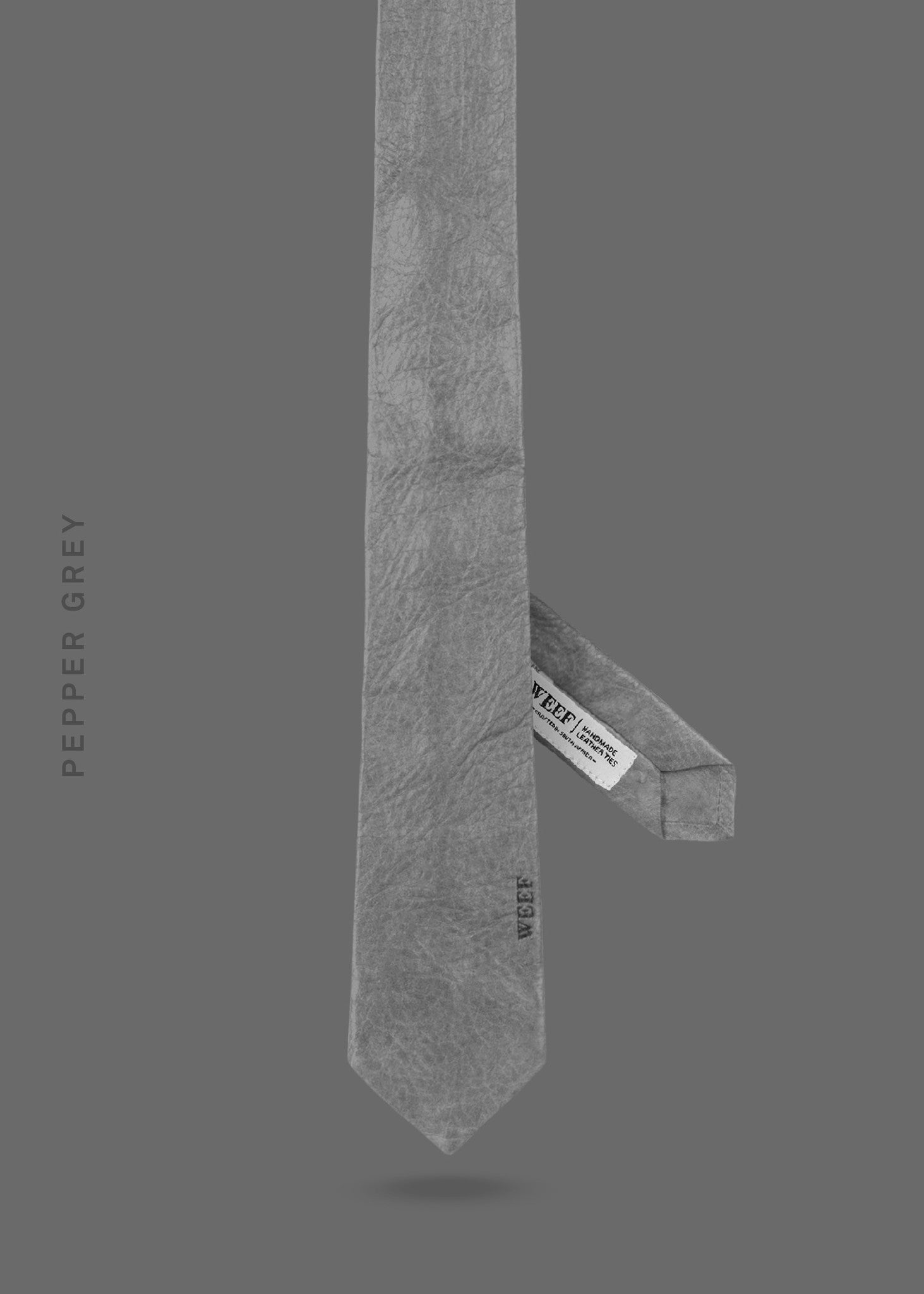 This pepper grey WEEF handmade leather tie is a great present or gift idea for dapper and stylish gentlemen for fathers day, valentines day or Christmas.