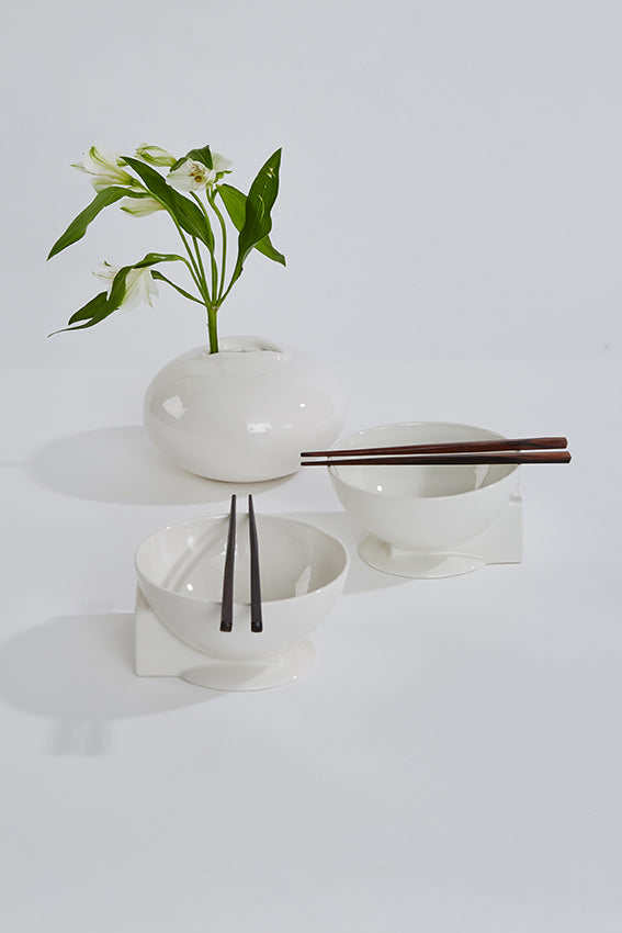 White ceramic bowls, sphere, cube shape, chop sticks