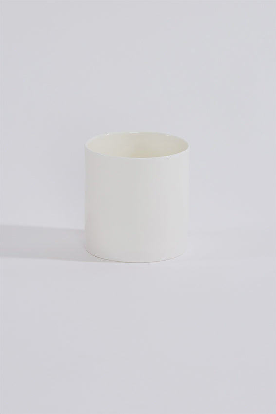 Ceramic china cup, no handle, and white