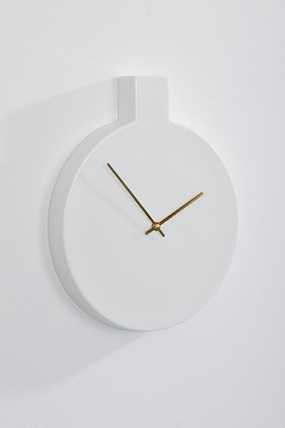 Ceramic wall clock, round, white, and gold hands