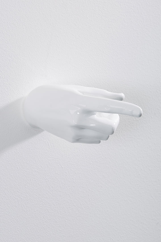 Hand wall art or hook, pointing gesture, and white colour