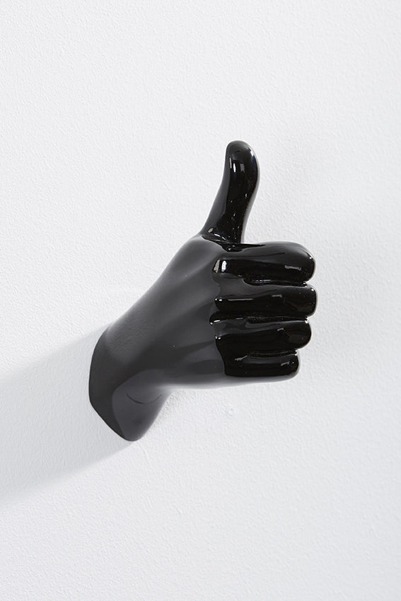 Hand wall art or hook, shape of thumbs up gesture, and black colour