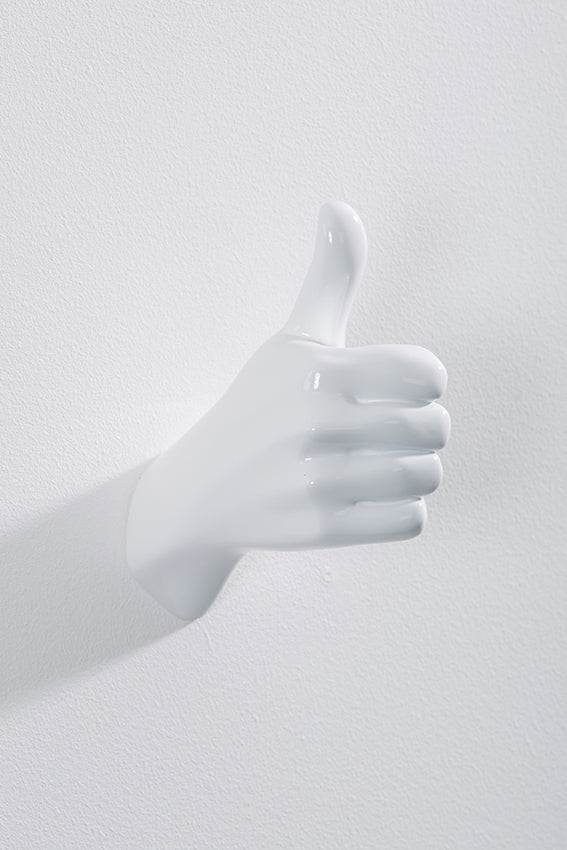 Hand wall art or hook, shape of thumbs up gesture, and white colour