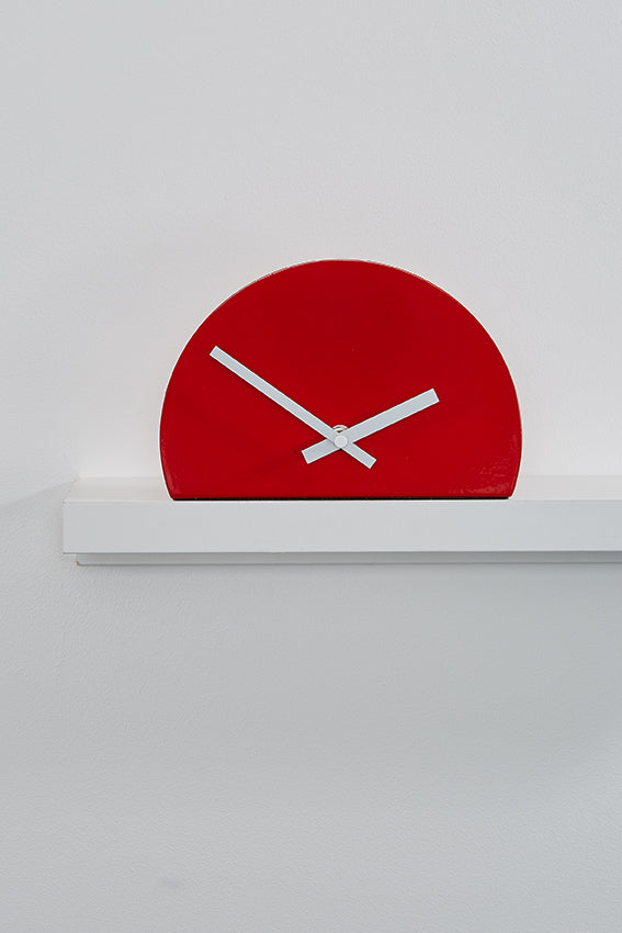Metal shelf clock, red, half shape, and white hands