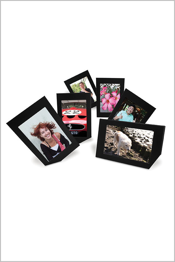 Black photo frames, six, leaning