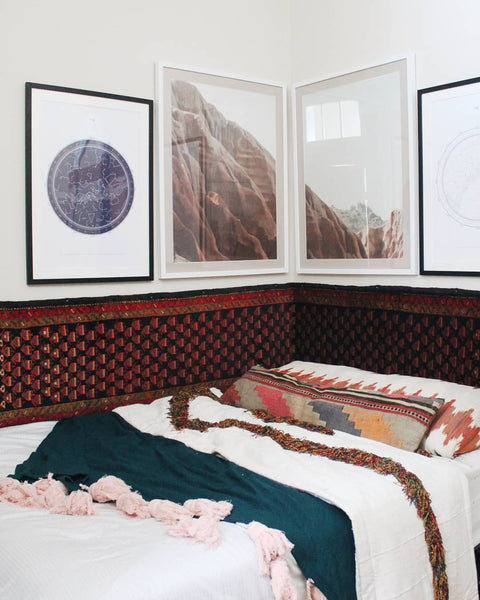 Liz Kamarul bedroom with vintage persian rug for the headboard