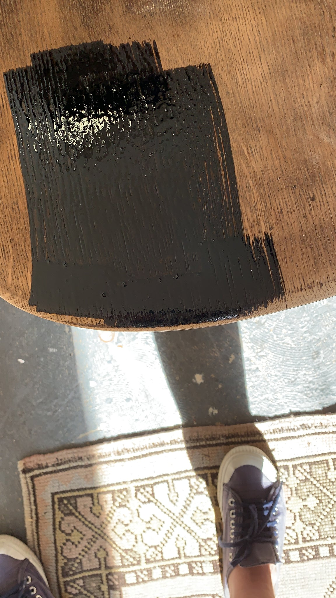Stain being applied to a wood chairs