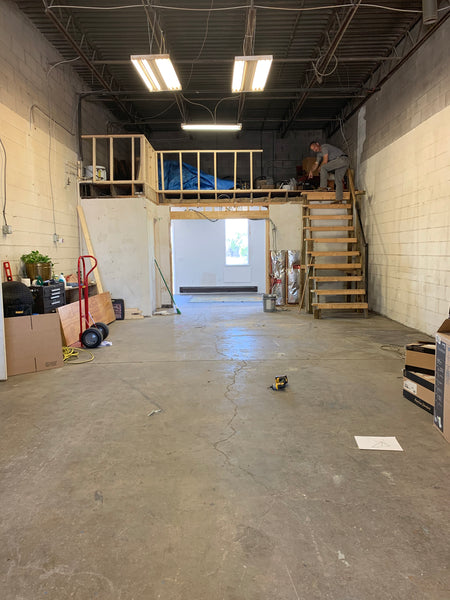 View of the studio renovation staircase + half wall progress