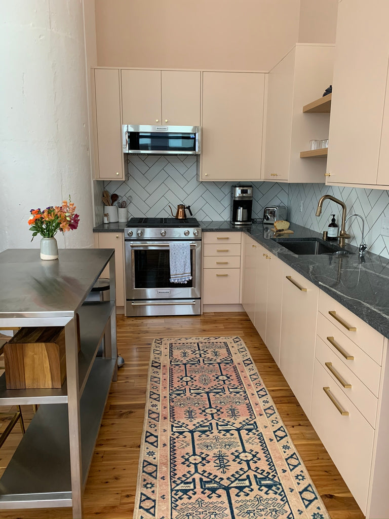 Pink kitchen featuring a vintage swoon rug