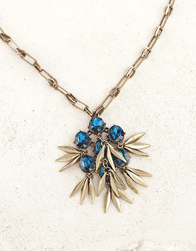Blue Gem Pendant with Gold Detailing