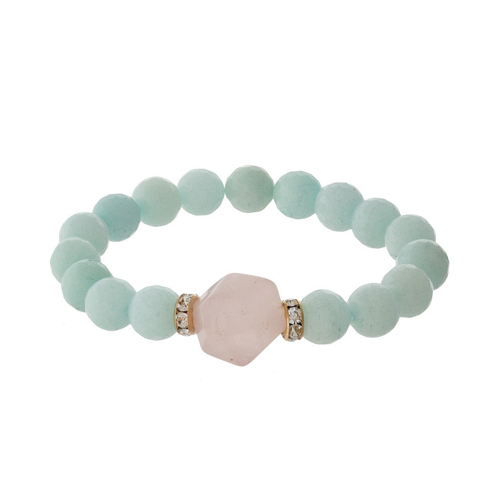 Mint beaded bracelet with pink accent stone