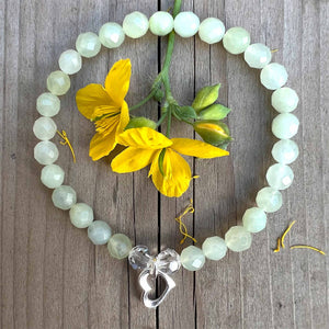 Courage Bracelet with Blue Calsilica Jasper, Onyx and Lotus Charm for strength.