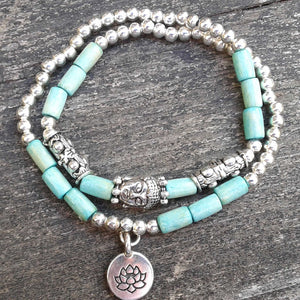 Blue and silver tone double strand lotus and buddha bracelet