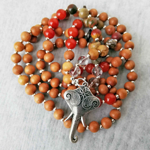 Carnelian, jasper, clear quartz, sandlewood mala beads with elephant symbol for guru bead.