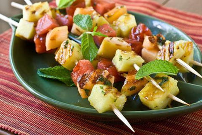 Fire pit grilled Fruit Skewers With Spicy Maple Cumin Glaze