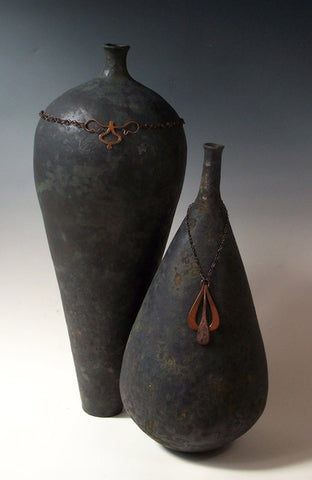 Pyramus & Thisbe, coiled pots plus metal adornments, by Kristin Doner