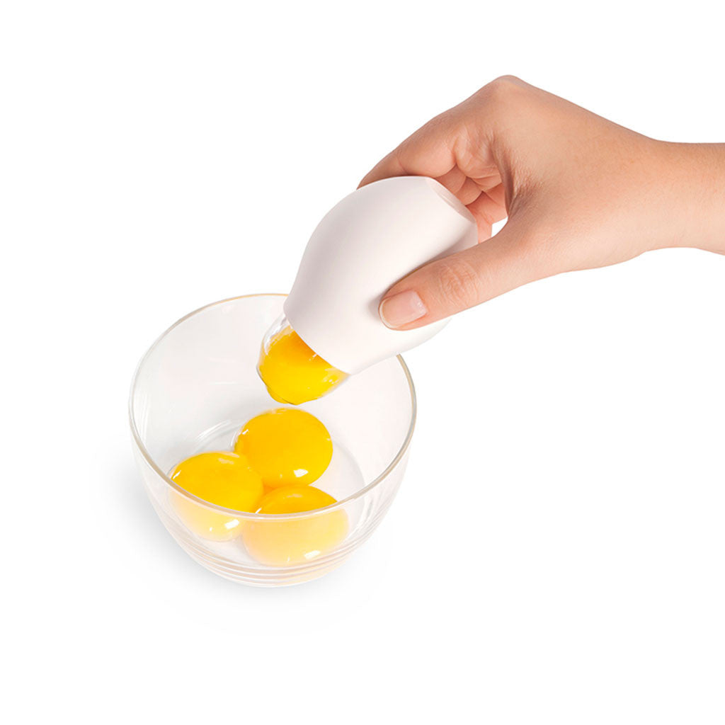 egg separator in hand - Quirky