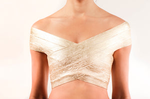 Crop top bandage metalico dorado