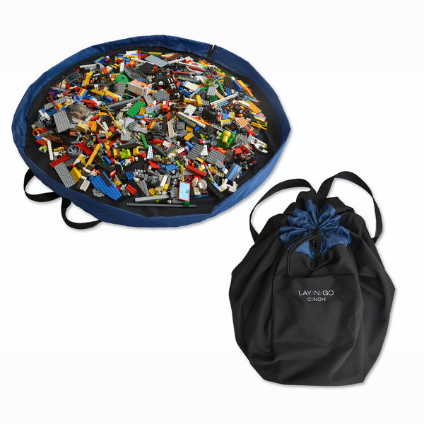 "Black and Blue Lay-n-Go CINCH (44"") backpack open and closed with LEGO organized inside"