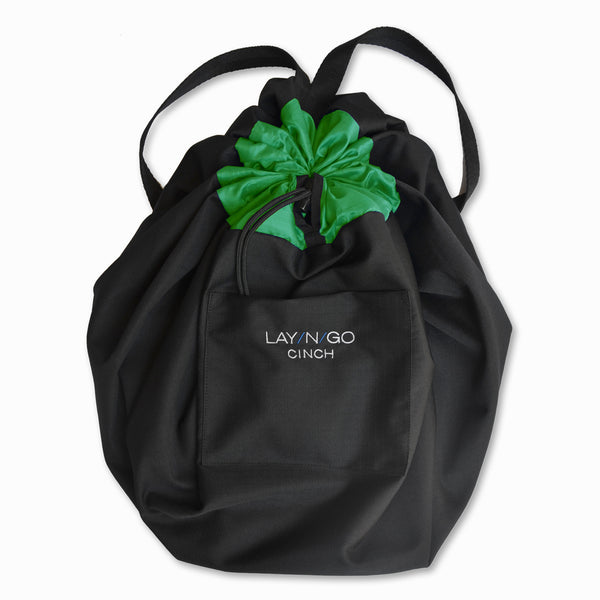 "Black and Green Lay-n-Go CINCH (44"") backpack completely closed to prevent content from falling out"