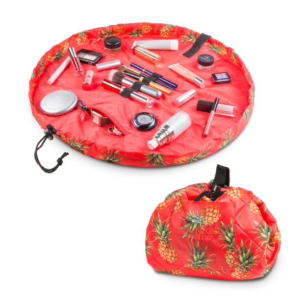 "Lay-n-Go COSMO Plus (21"") pineapple cosmetic bag shown open and closed"