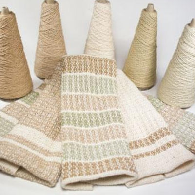 Cotton weaving cones and woven wash cloths