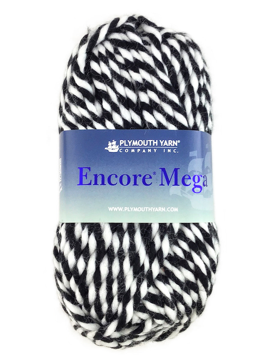 A black and white skein of Plymouth Encore Mega yarn