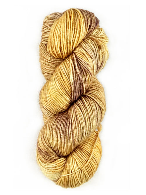 A multicolored skein of yellow and brown yarn