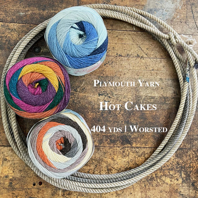 A lariat filled with colorful skeins of Plymouth Yarn Hot Cakes