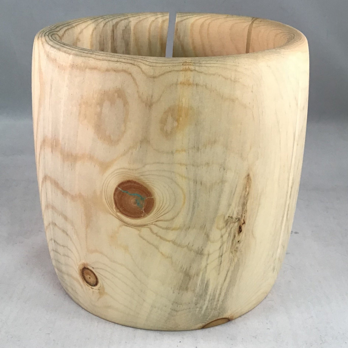 A wooden yarn bowl made from Pine Beetle kill wood against a white backdrop