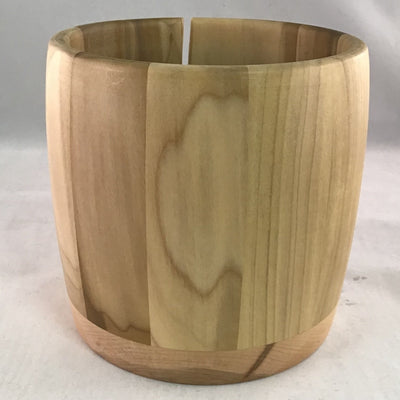 A wooden yarn bowl made from Poplar wood against a white backdrop