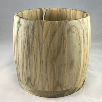 A wooden yarn bowl made from Ambrosia Pine Beetle kill wood against a white backdrop