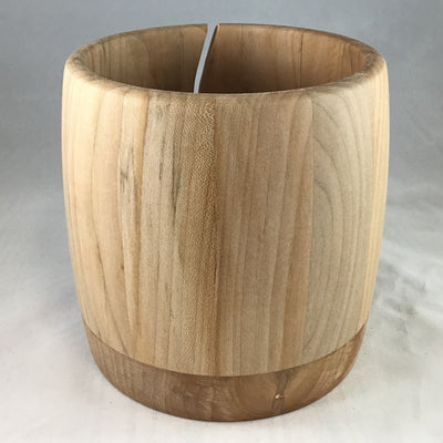 A wooden yarn bowl made from Red Birch wood against a white backdrop