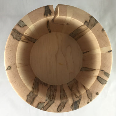 The inside of a wooden yarn bowl made from Ambrosia Ambrosia Maple wood against a white backdrop