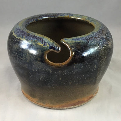 An earthy stoneware yarn bowl