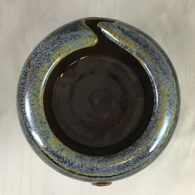 The inside of an earthy stoneware yarn bowl