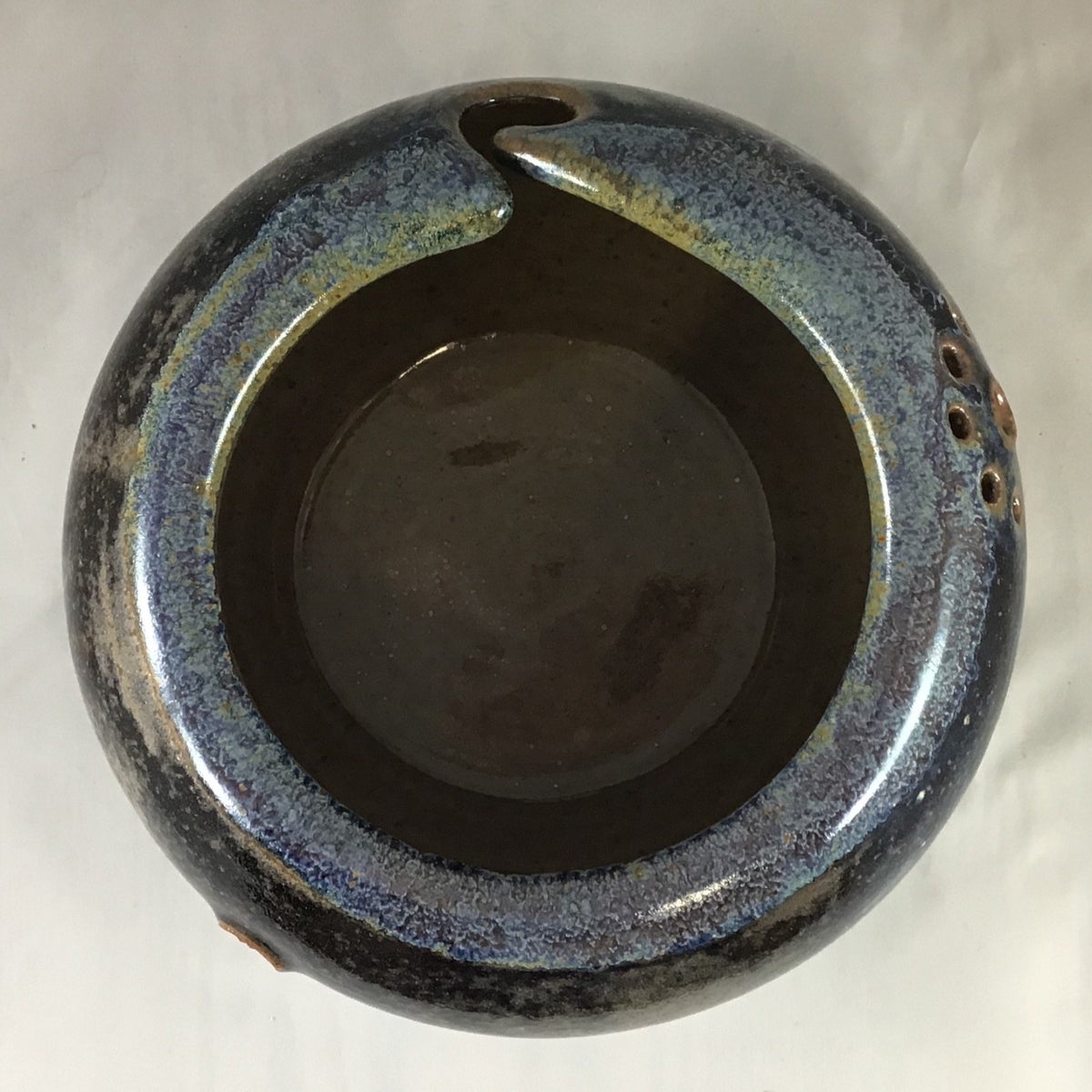 The inside of a grey stoneware yarn bowl