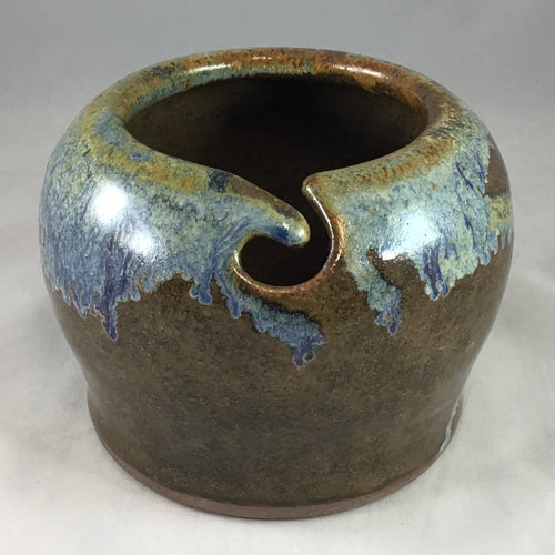 A brown and blue stoneware yarn bowl