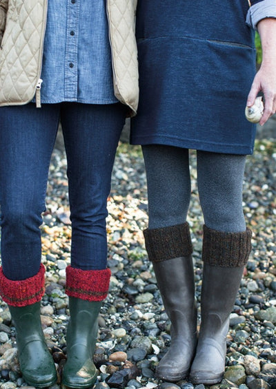 Two people wearing boots with boot cuff